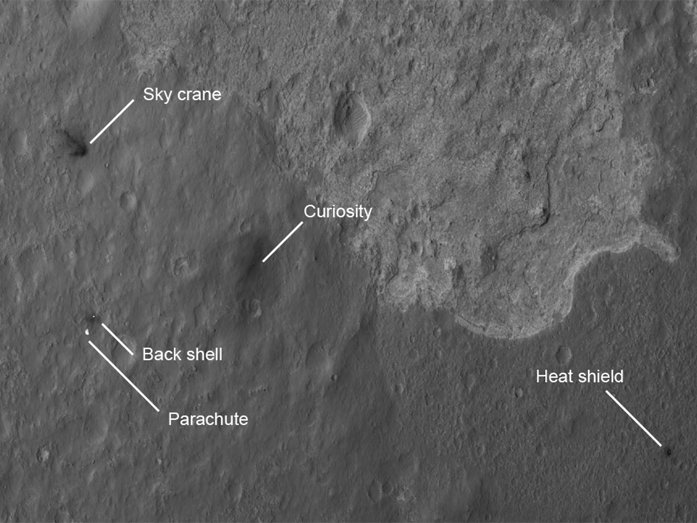 The four main pieces of hardware that arrived on Mars with NASA's Curiosity rover were spotted by NASA's Mars Reconnaissance Orbiter (MRO) which captured this image about 24 hours after landing.