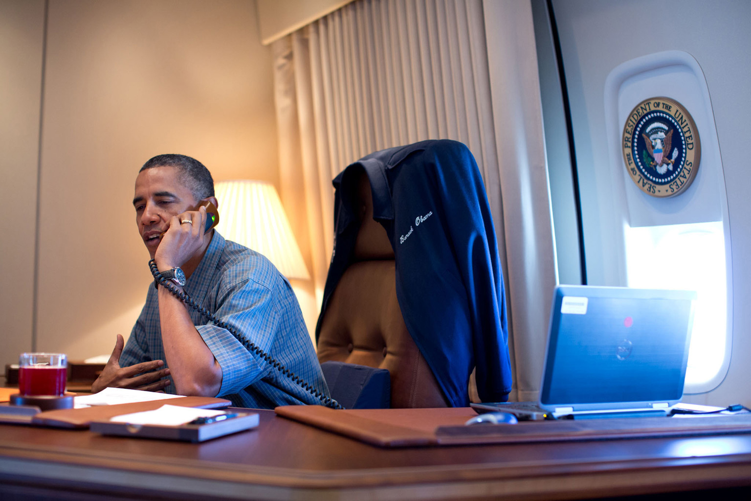 President Barack Obama talks on the phone with NASA's Curiosity Mars rover team aboard Air Force One during a flight to Offutt Air Force Base in Nebraska, Aug. 13, 2012. (Official White House Photo by Pete Souza)
