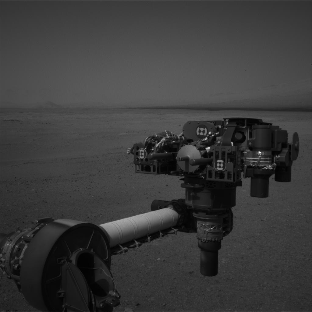 This full-resolution image from NASA's Curiosity shows the turret of tools at the end of the rover's extended robotic arm on Aug. 20, 2012. The Navigation Camera captured this view.