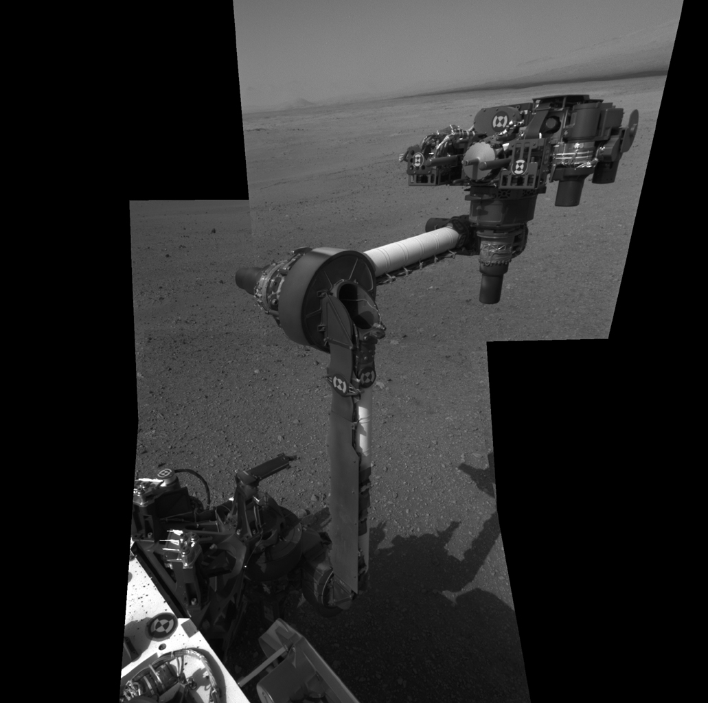 The extended robotic arm of NASA's Mars rover Curiosity can be seen in this mosaic of full-resolution images from Curiosity's Navigation camera (Navcam). Curiosity extended its arm on Aug. 20, 2012.