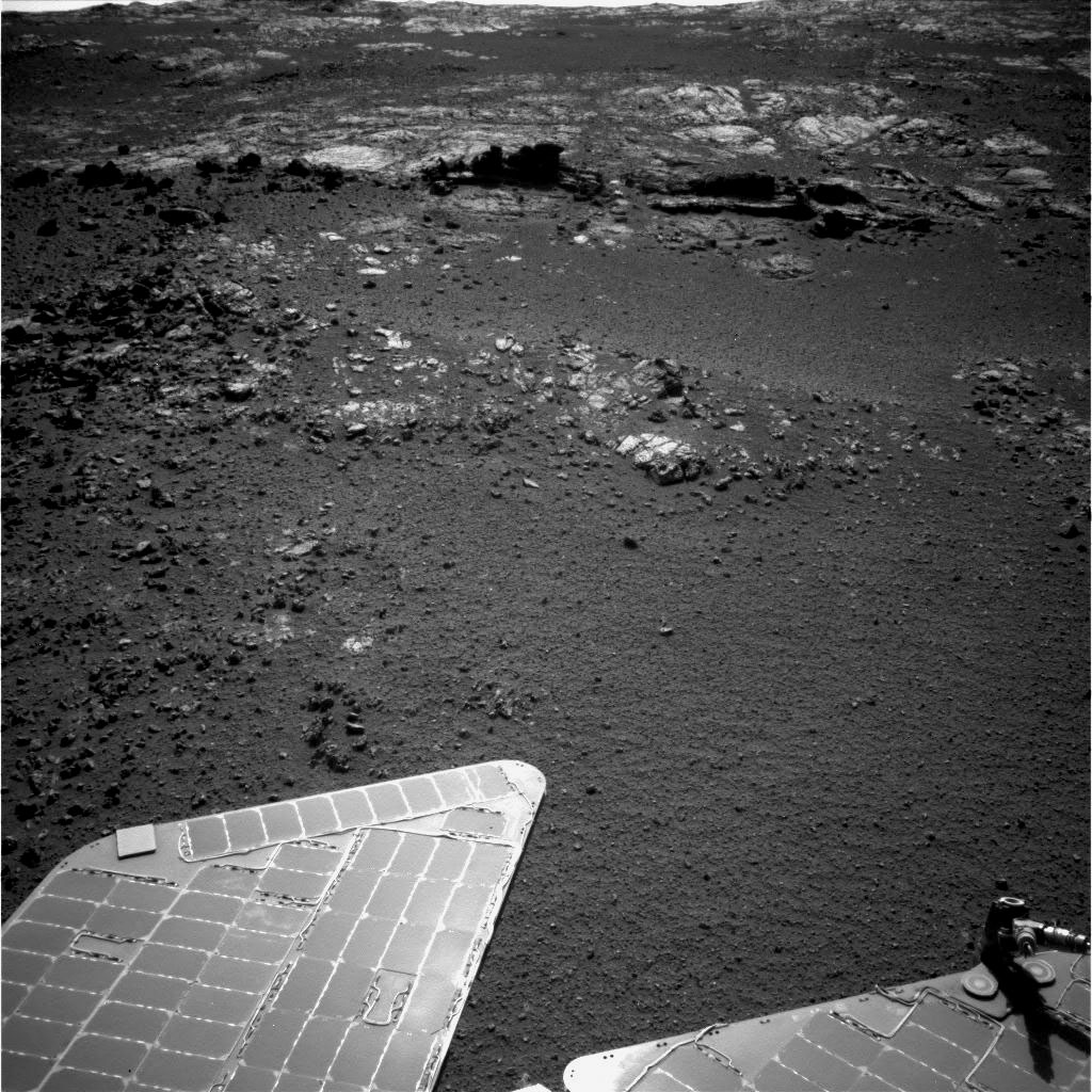 The team operating NASA's Mars Exploration Rover Opportunity plans to investigate rocks in this area. Both the dark fins and the paler outcrop beyond them hold potential targets for studying with instruments on the rover.
