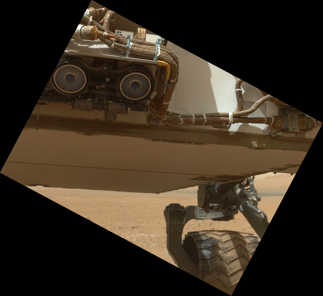 This view of the lower front and underbelly areas of NASA's Mars rover Curiosity was taken by the rover's MAHLI camera during Sept. 9, 2012. Also visible are the hazard avoidance cameras on the front of the rover.