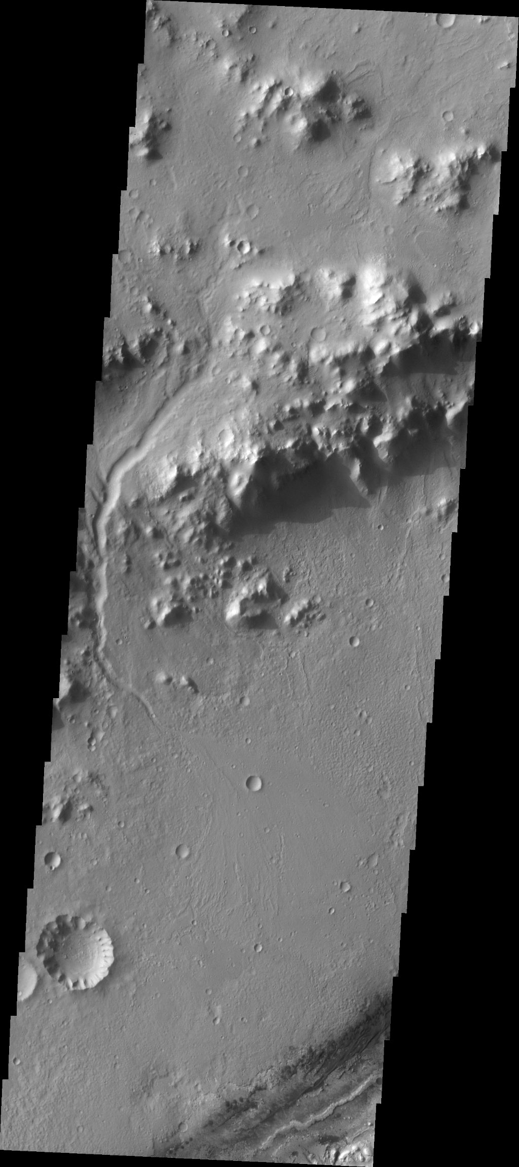 This image captured by NASA's 2001 Mars Odyssey spacecraft contains the landing site in the bottom right portion of the image, near the dark dunes. Note the channel that cuts through the crater rim on the left side of the image.