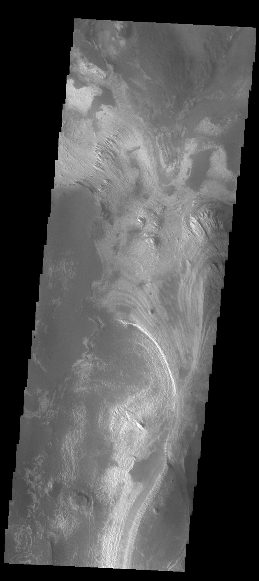 This image captured by NASA's 2001 Mars Odyssey spacecraft shows the part of the floor of Melas Chasma. Melas Chasma in the central chasma of Valles Marineris.