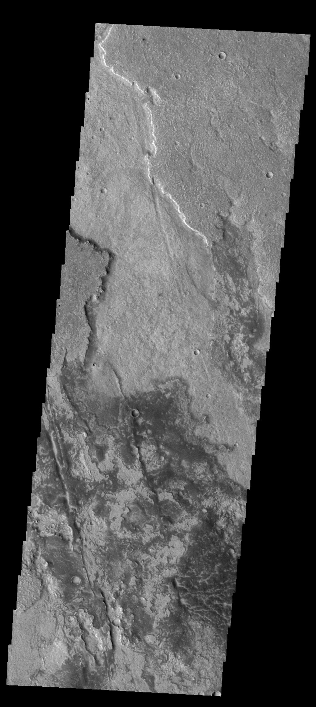 This image captured by NASA's 2001 Mars Odyssey spacecraft shows a small portion of the lava flows of Solis Planum.
