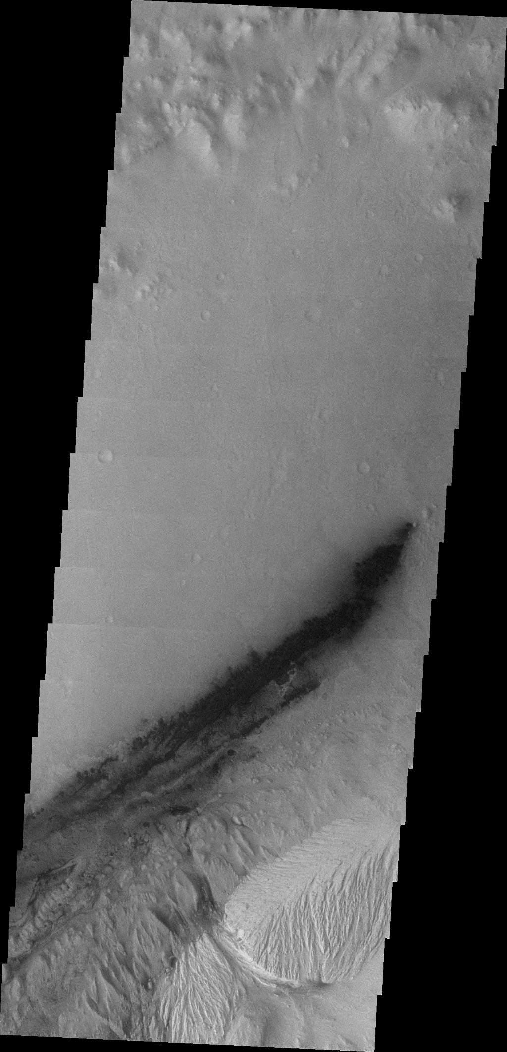 This image captured by NASA's 2001 Mars Odyssey spacecraft shows Gale Crater, which contains the landing site of the Mars rover, Curiosity; the rover will have to navigate sand dunes to get to Mt. Sharp.