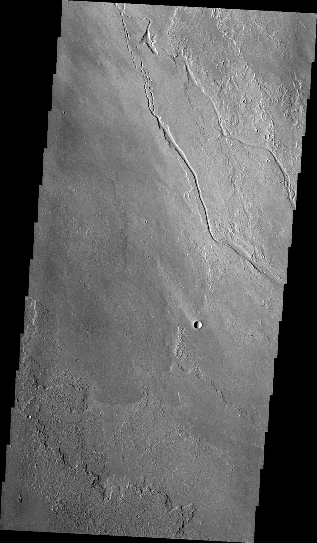 The channels in this image from NASA's 2001 Mars Odyssey spacecraft were created by the flow of lava rather than water. These lava channels are near the northeast flank of Olympus Mons.