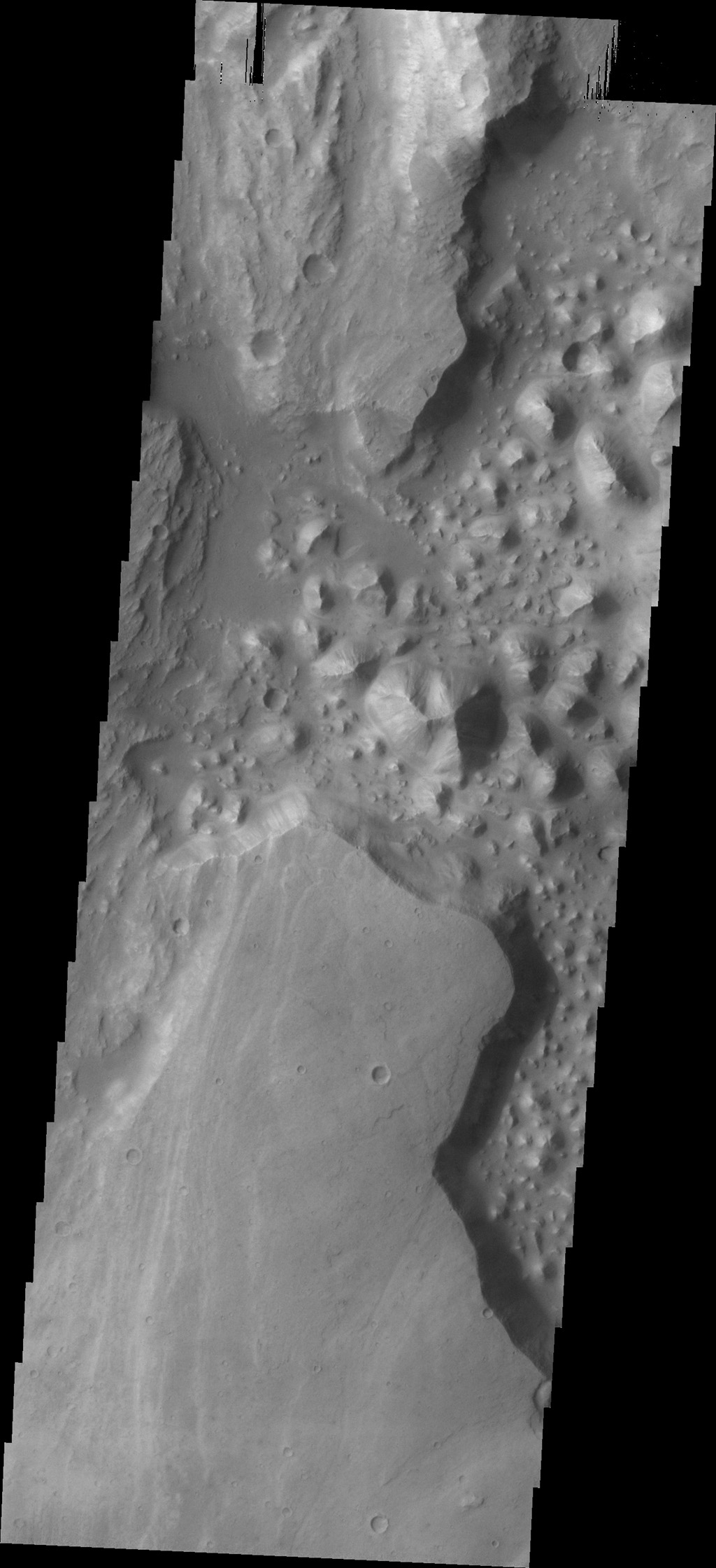 The hills (chaos) in this image from NASA's 2001 Mars Odyssey spacecraft are located between Stege Crater, just outside of the image to the northeast, and Maja Valles (left side of image).