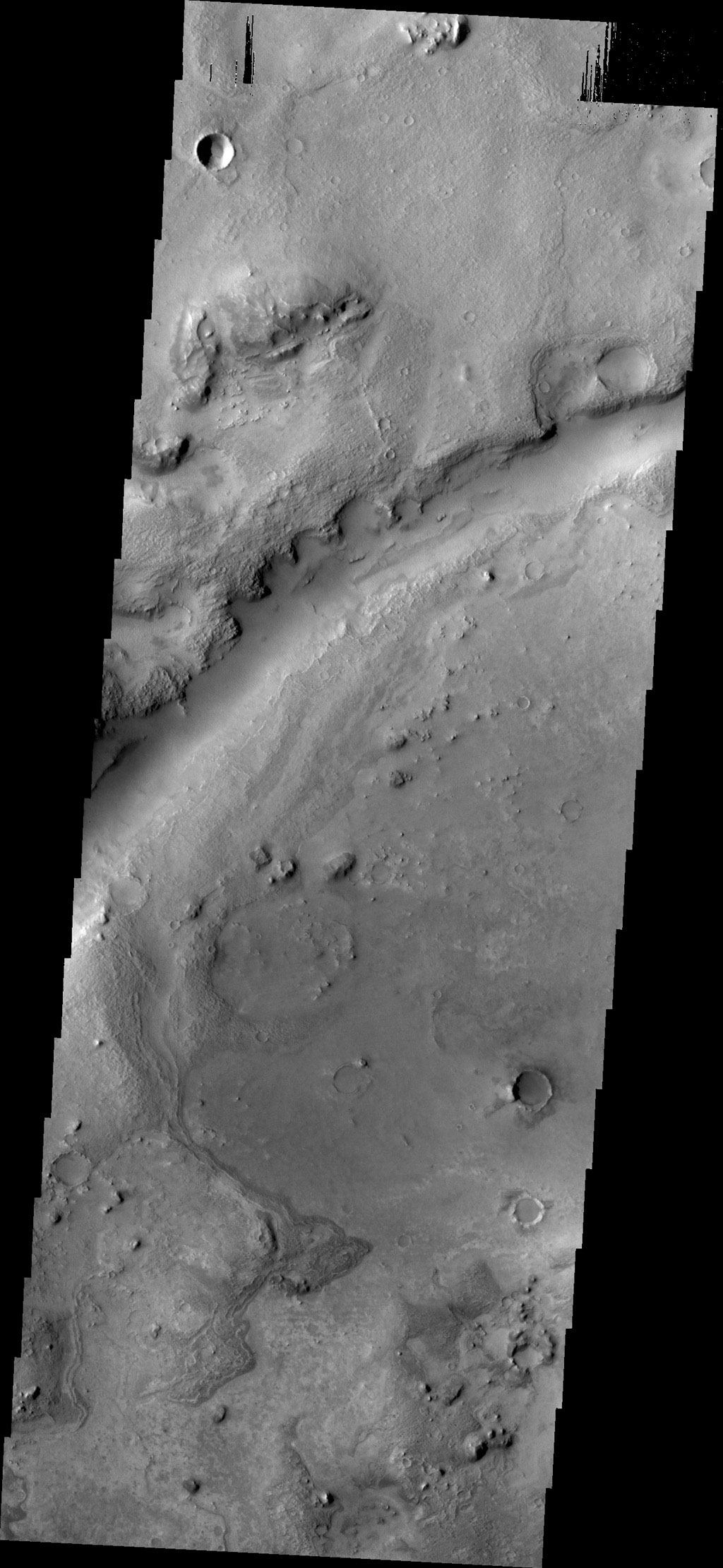 What appears to be a channel in this image captured by NASA's 2001 Mars Odyssey spacecraft is actually one of the fractures that make up Nili Fossae.
