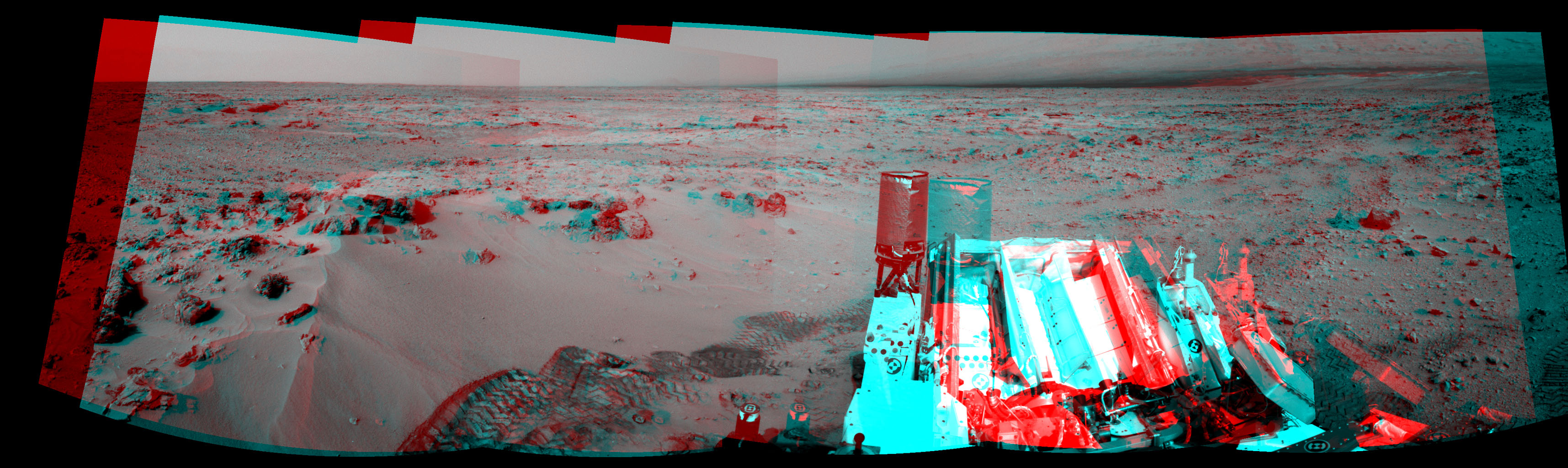NASA's Mars rover Curiosity drove 6.2 feet (1.9 meters) during the 100th Martian day, or sol, of the mission (Nov. 16, 2012). The rover used its Navigation Camera after the drive to record the images combined into this 3-D panoramic view.