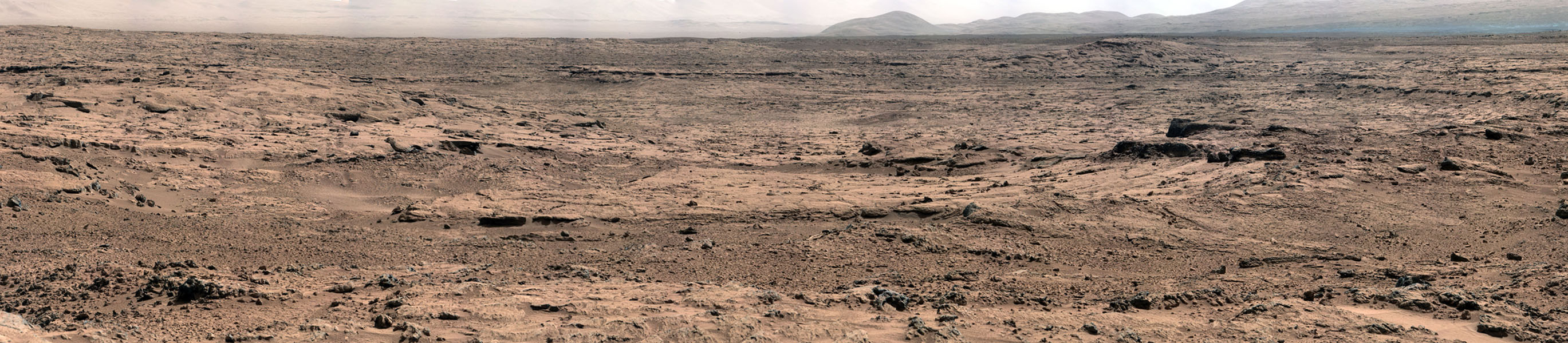 The image, which has been white-balanced to show what the rocks and soils in it would look like if they were on Earth, is a mosaic of images taken at a site called 'Rocknest' while NASA's Mars rover Curiosity was working.