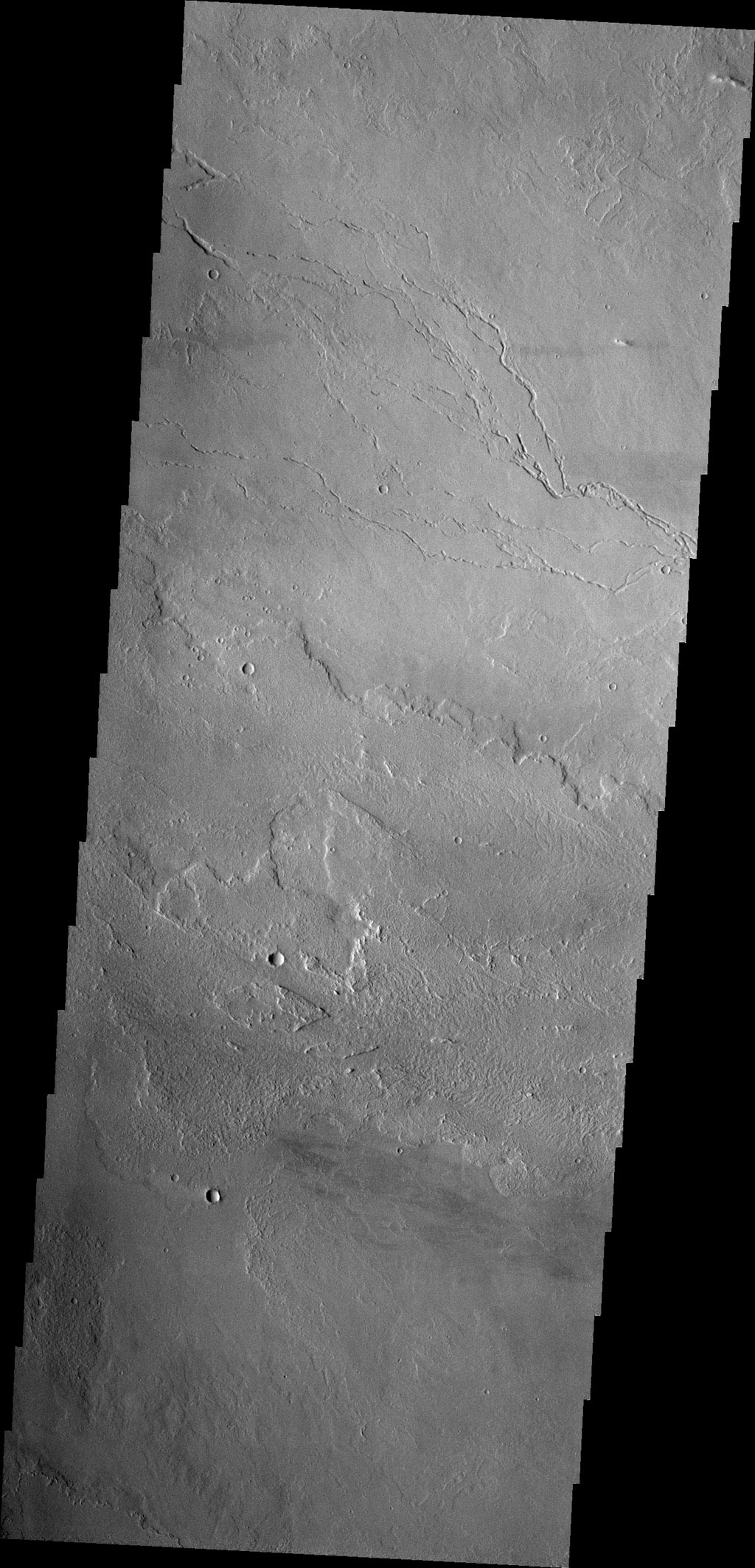 Lava channels east of Olympus Mons as seen by NASA's 2001 Mars Odyssey spacecraft.