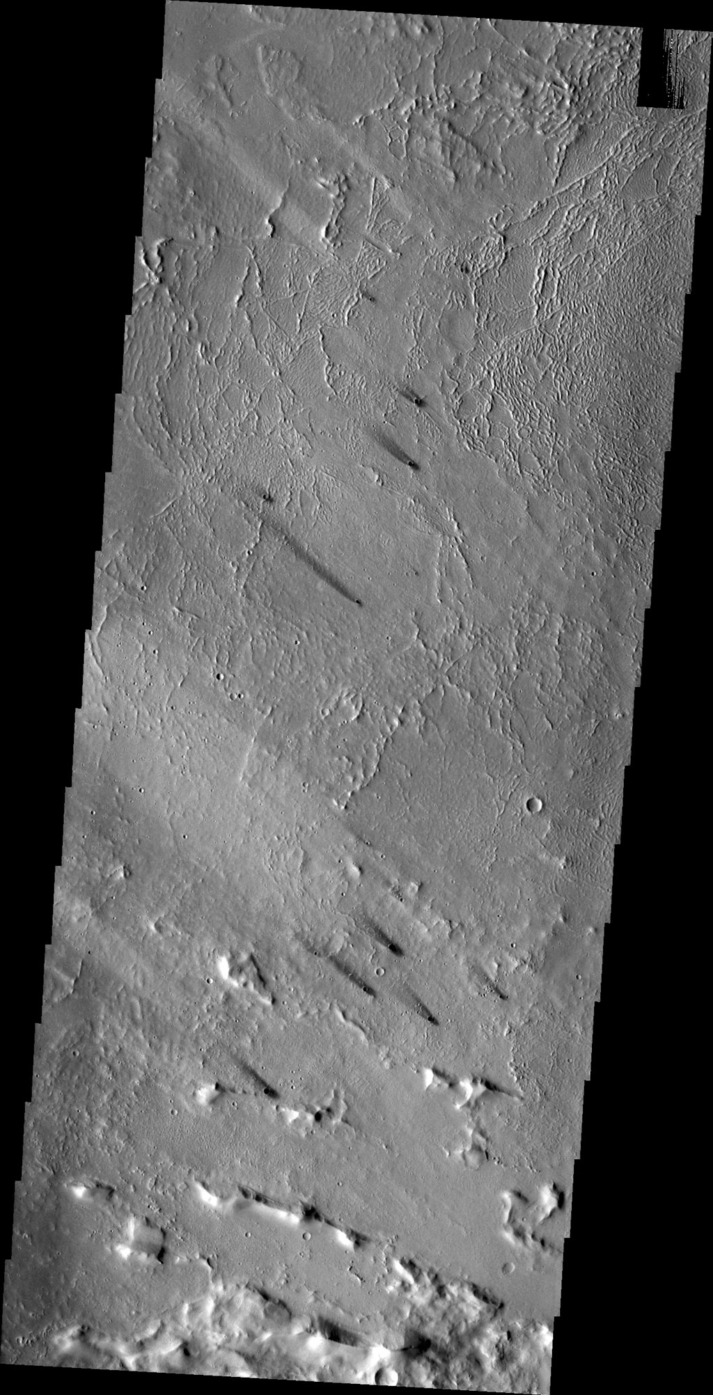 The small dark windstreaks as seen by NASA's 2001 Mars Odyssey spacecraft are located near Lycus Sulci.