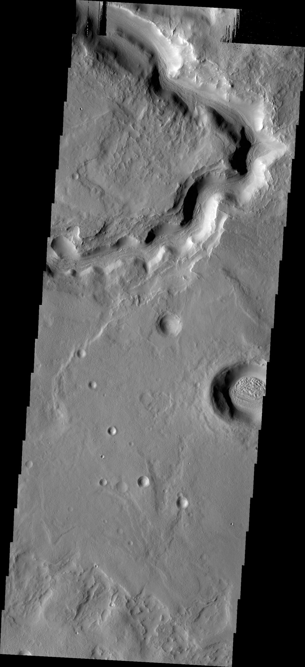 This image captured by NASA's 2001 Mars Odyssey spacecraft shows a portion of an unnamed channel near Auqakuh Vallis.