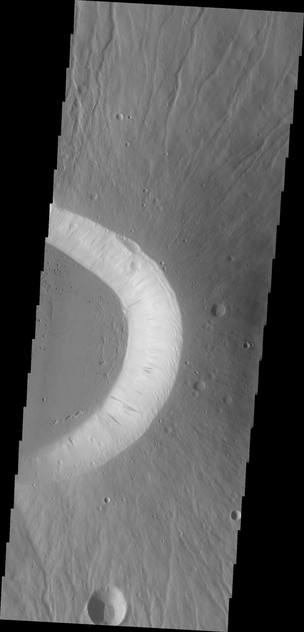 Today's image shows the eastern side of the summit caldera of Ceraunius Tholus as seen by NASA's 2001 Mars Odyssey spacecraft.