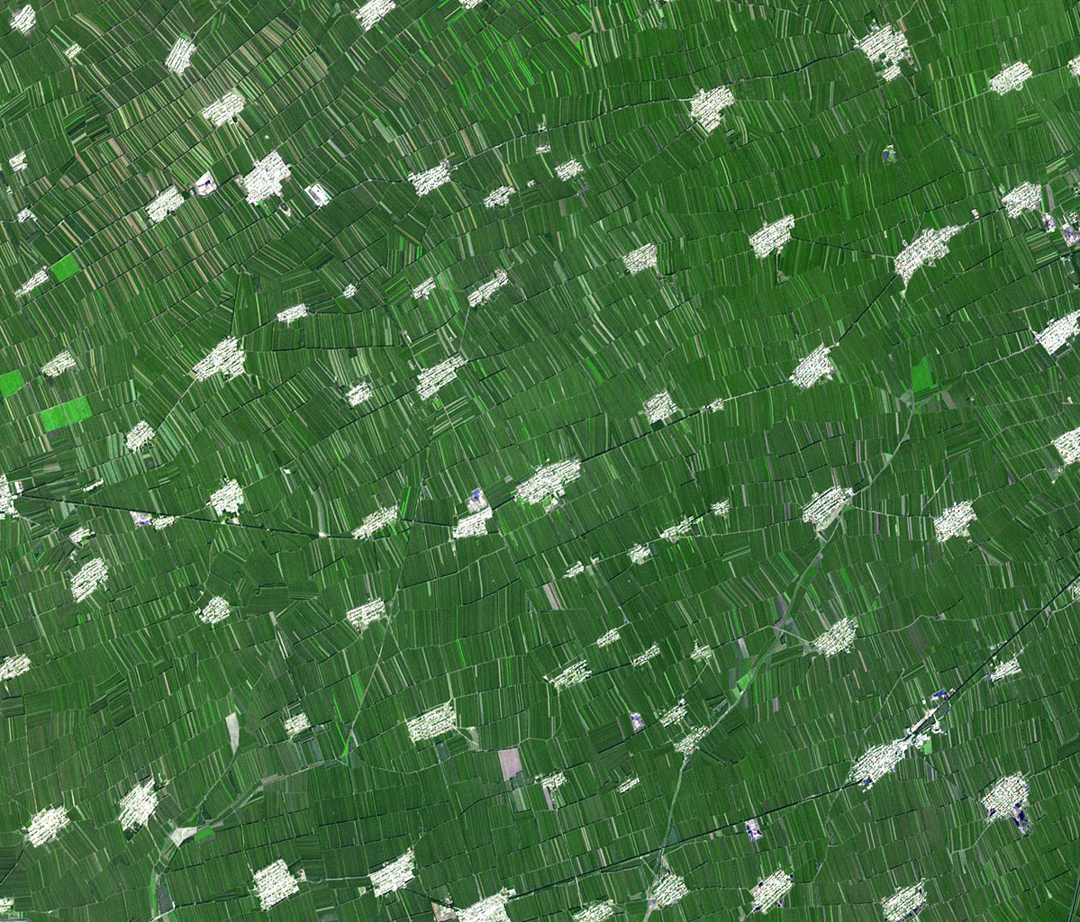 Acquired by NASA's Terra spacecraft, this image shows Heilongjiang, a province of China located in the northeastern part of the country. Farms are small and long skinny rectangles in shape, surrounding regularly spaced villages.