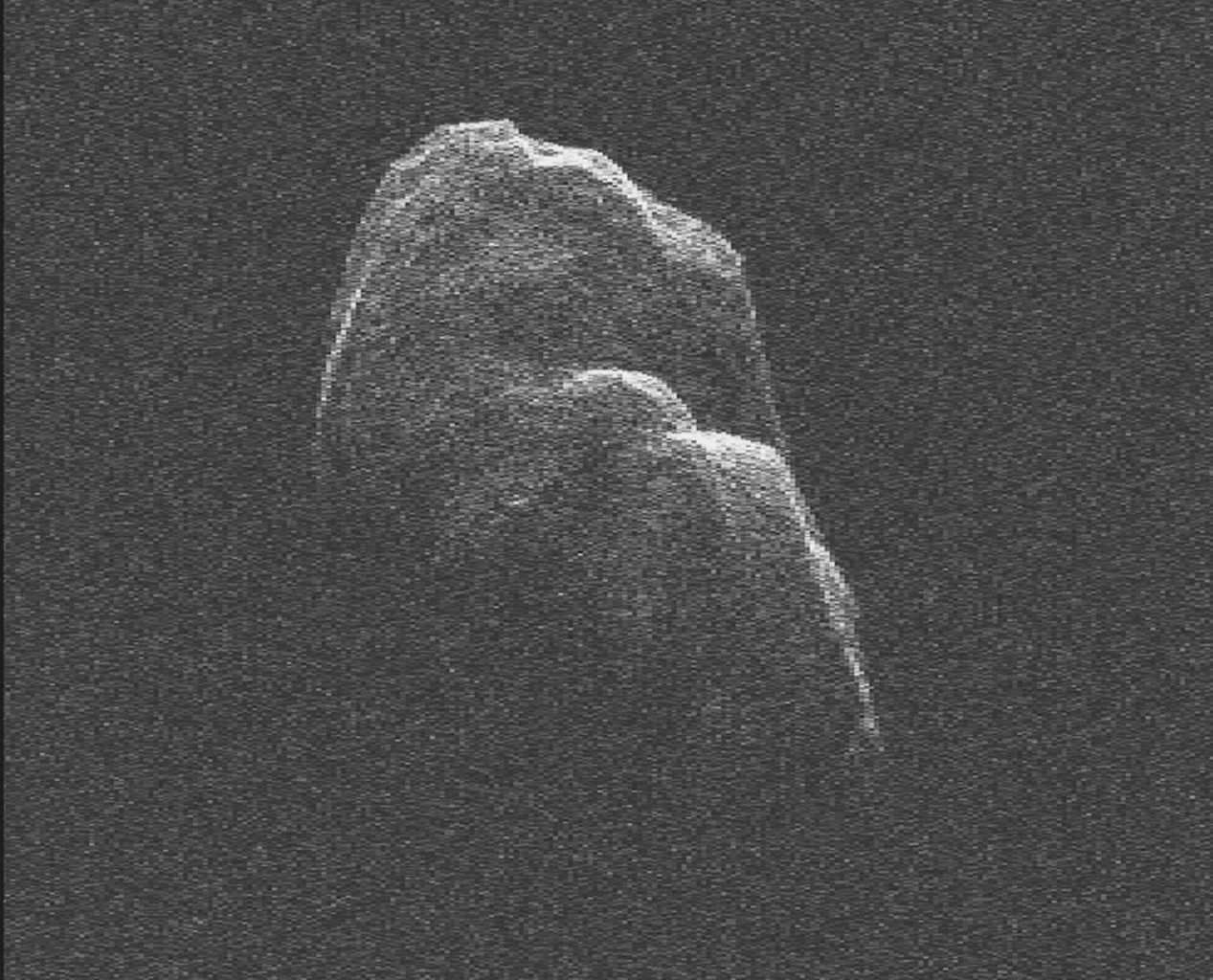 This image of asteroid Toutatis was generated with data collected using NASA's Deep Space Network antenna at Goldstone, Calif., on Dec. 12 and 13, 2012 and indicates that it is an elongated, irregularly shaped object with ridges and perhaps craters.