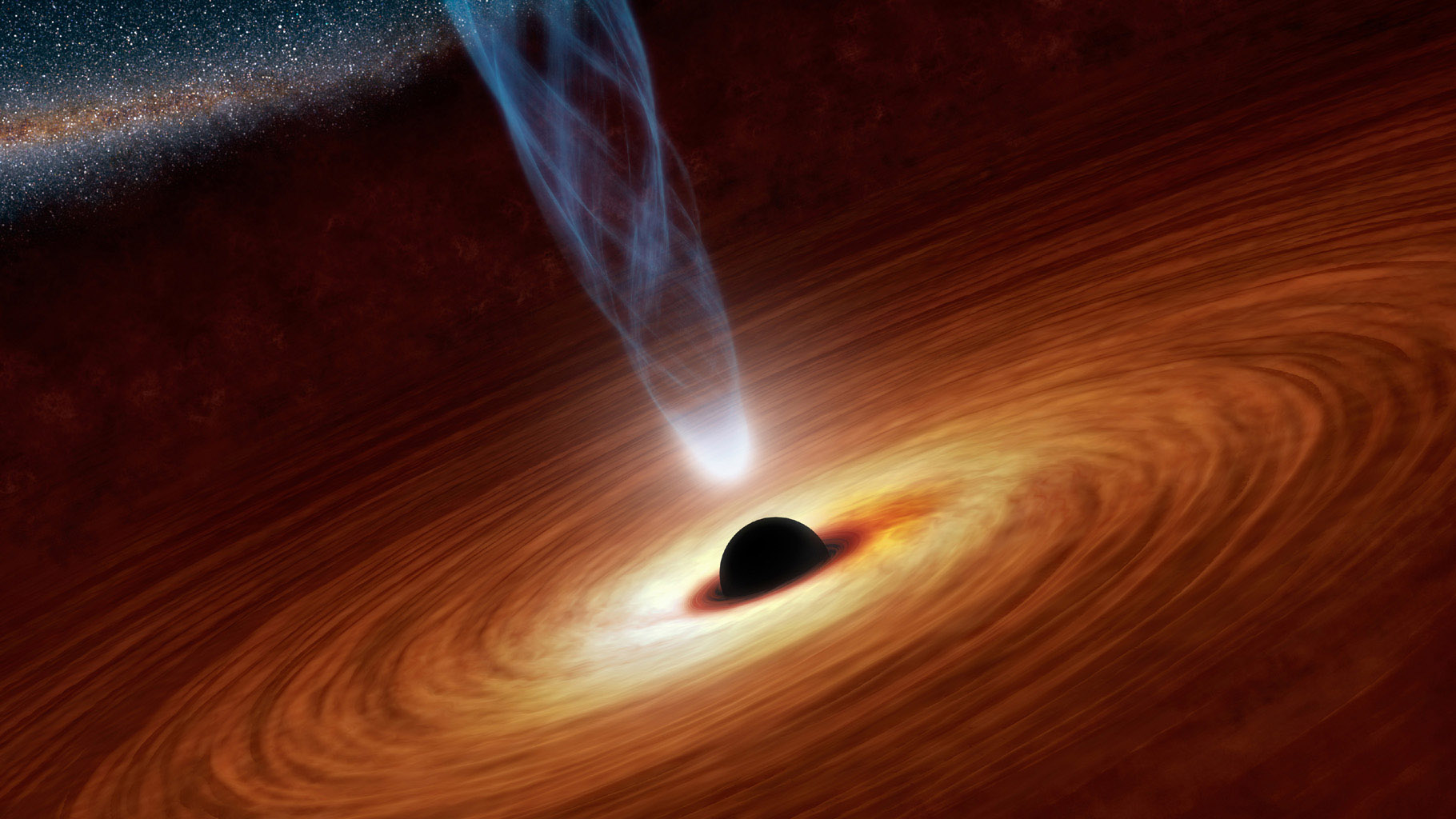 This artist's concept illustrates a supermassive black hole with millions to billions times the mass of our sun. Supermassive black holes are enormously dense objects buried at the hearts of galaxies.