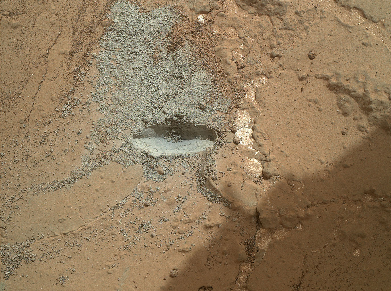 The bit in the rotary-percussion drill of NASA's Mars rover Curiosity left its mark in a target patch of rock called 'John Klein' during a test on Feb. 2, 2013, in preparation for the first drilling of a rock by the rover.