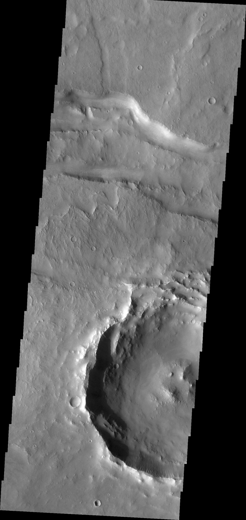 This image from NASA's 2001 Mars Odyssey spacecraft shows a small portion of a east/west trending fracture in Thaumasia Planum on Mars.