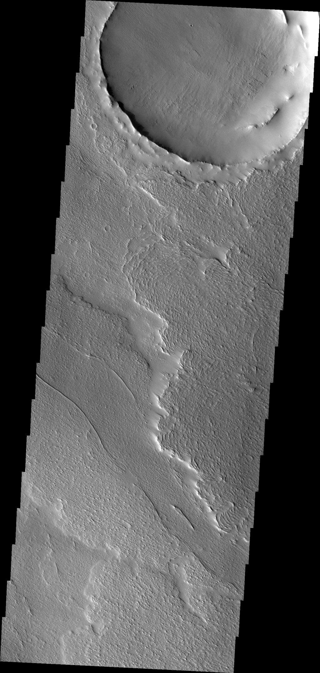 The lava flows in this image captured by NASA's 2001 Mars Odyssey spacecraft are located on the northeastern margin of Daedalia Planum. Wind deposits are visible in the lee of the flow fronts.