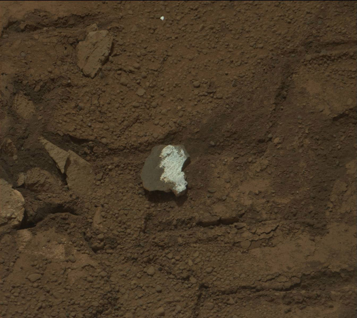 This raw image of 'Tintina,' a broken rock fragment in a rover wheel track, was taken by Curiosity's Mast Camera (Mastcam).