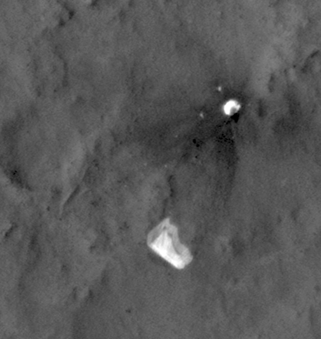This image from NASA's Mars Reconnaissance Orbiter shows wind-caused changes in the parachute of NASA's Mars Science Laboratory spacecraft as the chute lay on the Martian ground during months after its use in safe landing of the Curiosity rover.
