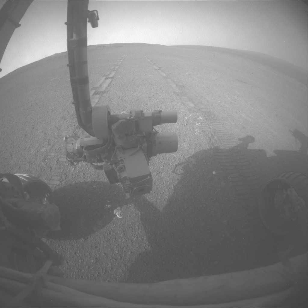 This image was taken by Opportunity's front hazard-avoidance camera after the Sol 3309 drive, looking back at the tracks produced while the rover was driving in reverse, as it often does.