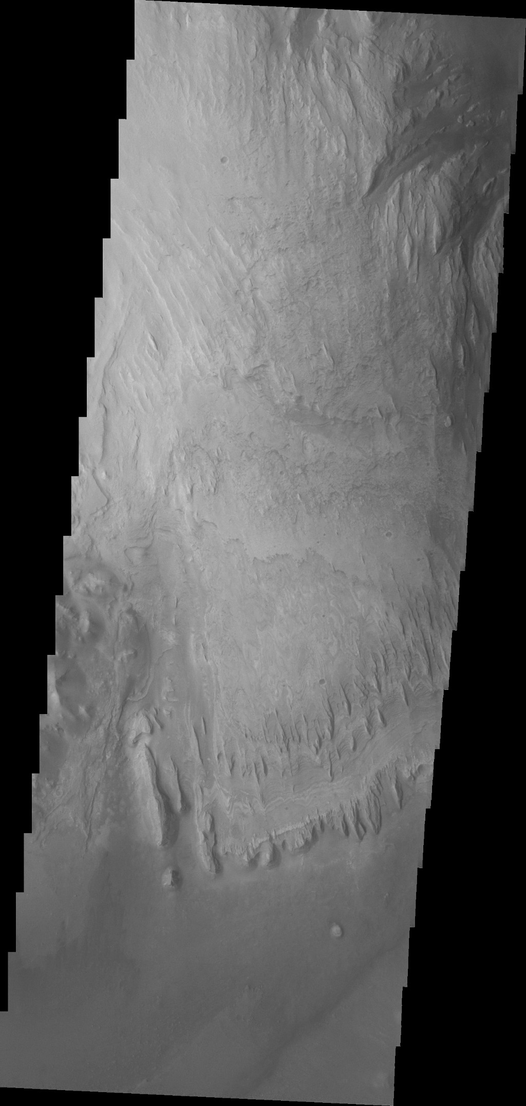 This image captured by NASA's 2001 Mars Odyssey spacecraft shows more of the weathering of the eastern side of Mt. Sharp.