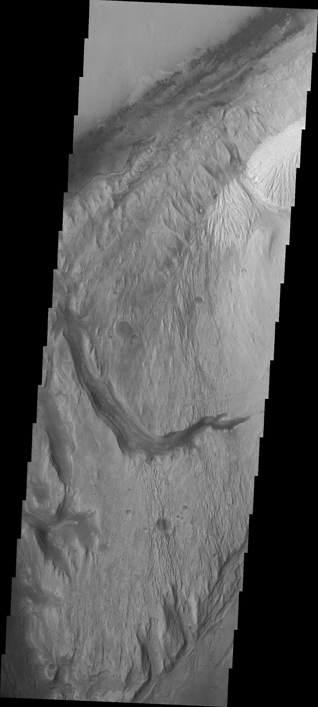 This image captured by NASA's 2001 Mars Odyssey spacecraft continues to follow the channel seen in the past two images. The rover landing site is at the top margin of this image.