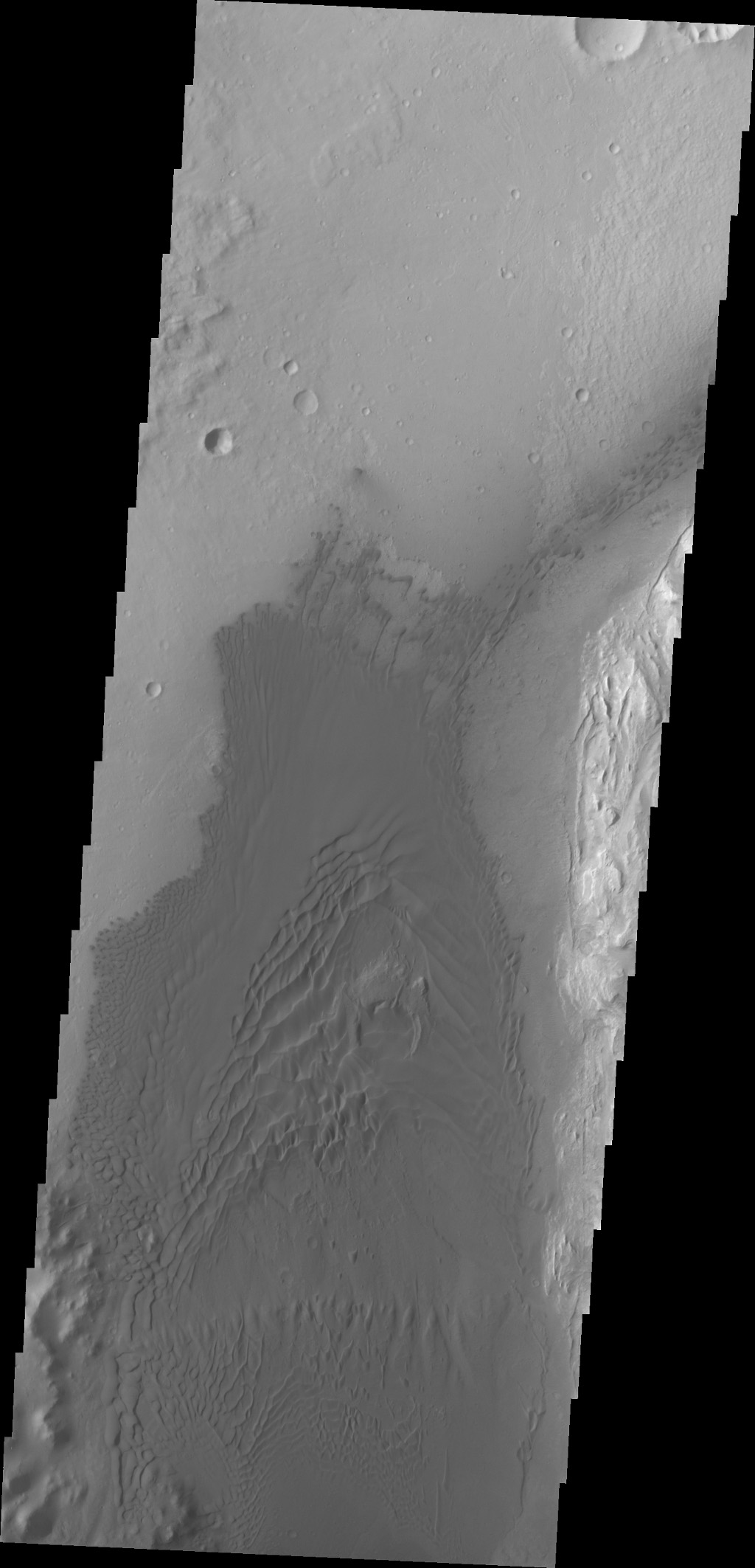 This image captured by NASA's 2001 Mars Odyssey spacecraft of the western floor of Gale Crater shows the large region of sand and sand dunes present southwest of the landing site.