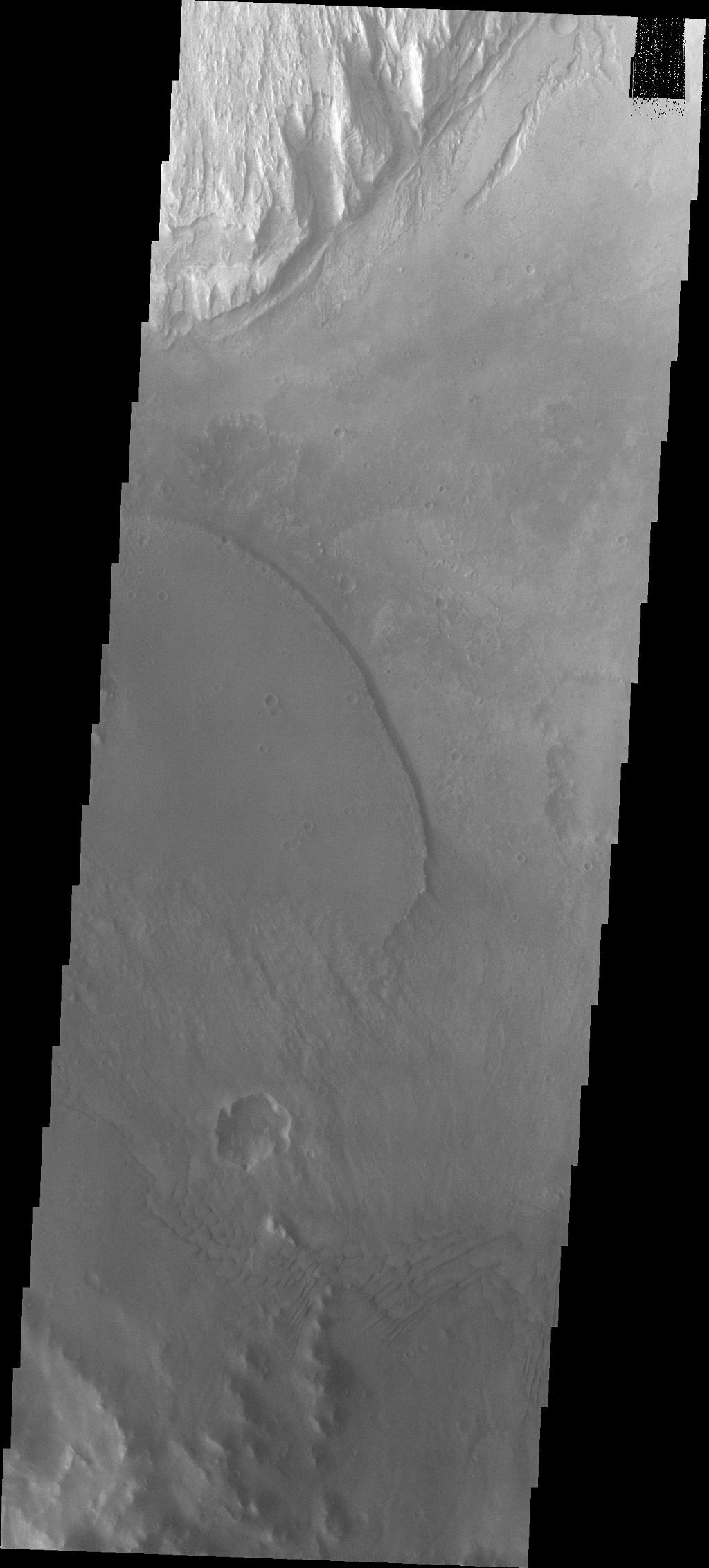 Moving eastward across the southern part of Gale Crater, this image from NASA's Mars Odyssey spacecraft shows more dark material deposited from the large channel through the SW rim of crater; material has a sharp edge where it overlays the crater floor.