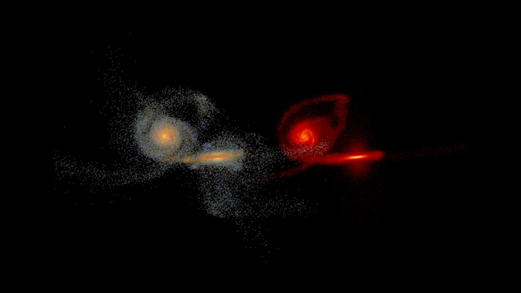 This frame from a simulation shows the merging of two massive galaxies. The merging galaxies are split into two views: a visible-light view on the left, and infrared view on the right.