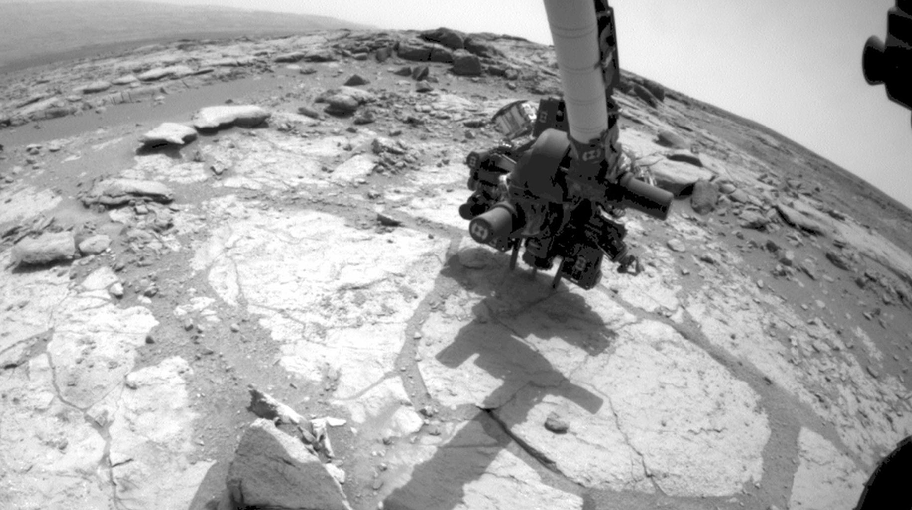 This frame from an animation from NASA's Mars rover Curiosity shows the rover drilling into rock target 'Cumberland.' The drilling was performed during the 279th Martian day, or sol, of the Curiosity's work on Mars (May 19, 2013).