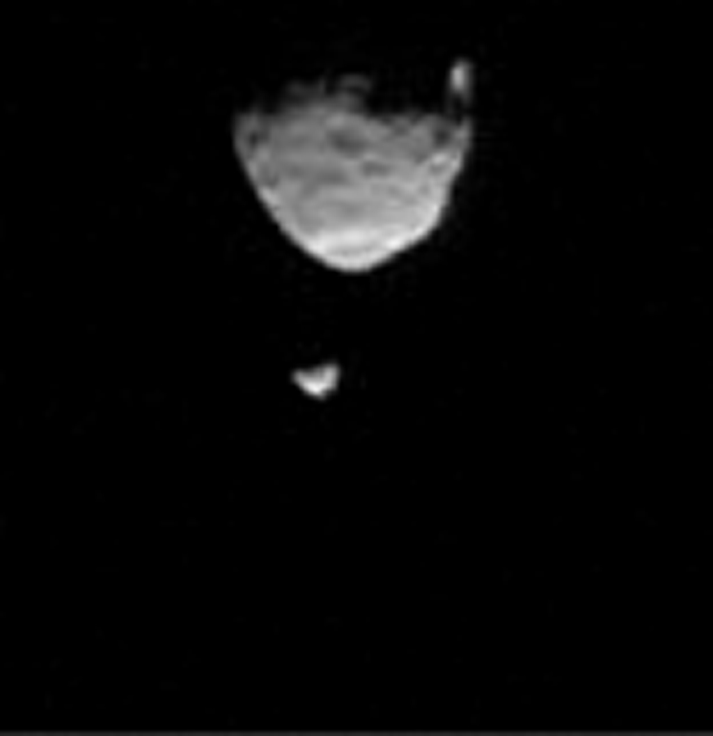 This frame from a movie clip shows the larger of Mars' two moons, Phobos, passing in front of the smaller Martian moon, Deimos, as observed by NASA's Mars rover Curiosity.