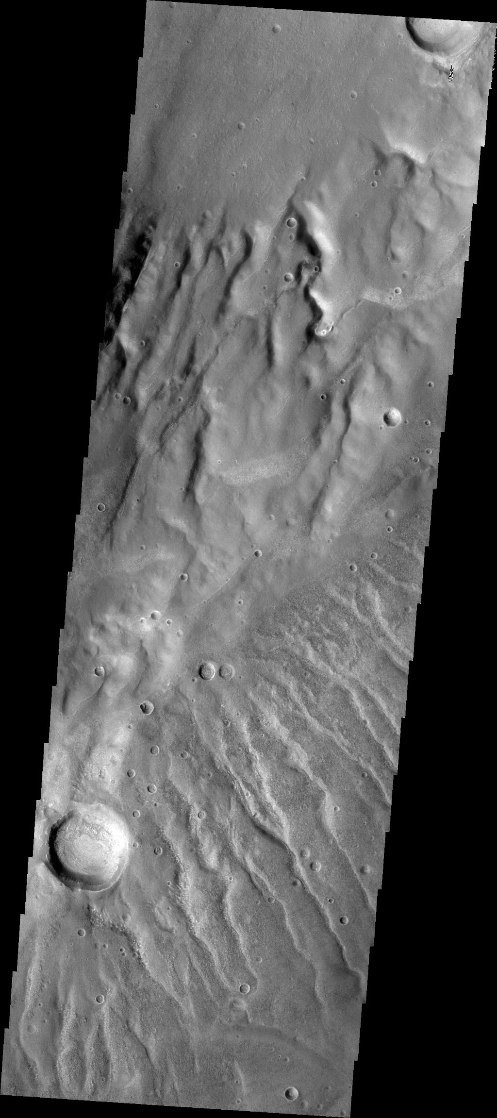 Numerous channels dissect both sides of this high spot south of Solis Planum in this image captured by NASA's 2001 Mars Odyssey spacecraft.