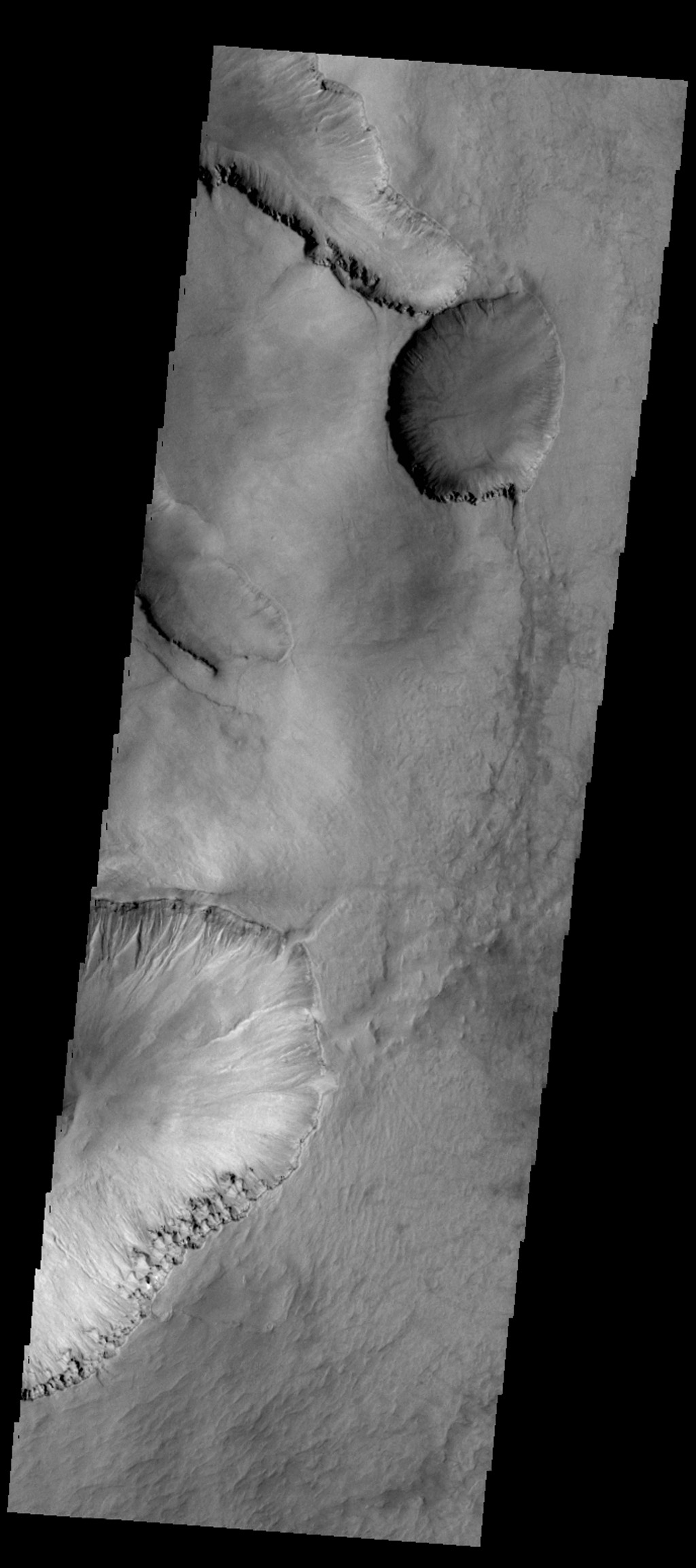 The depressions in this image captured by NASA's 2001 Mars Odyssey spacecraft are located in the material that fills Asimov Crater.