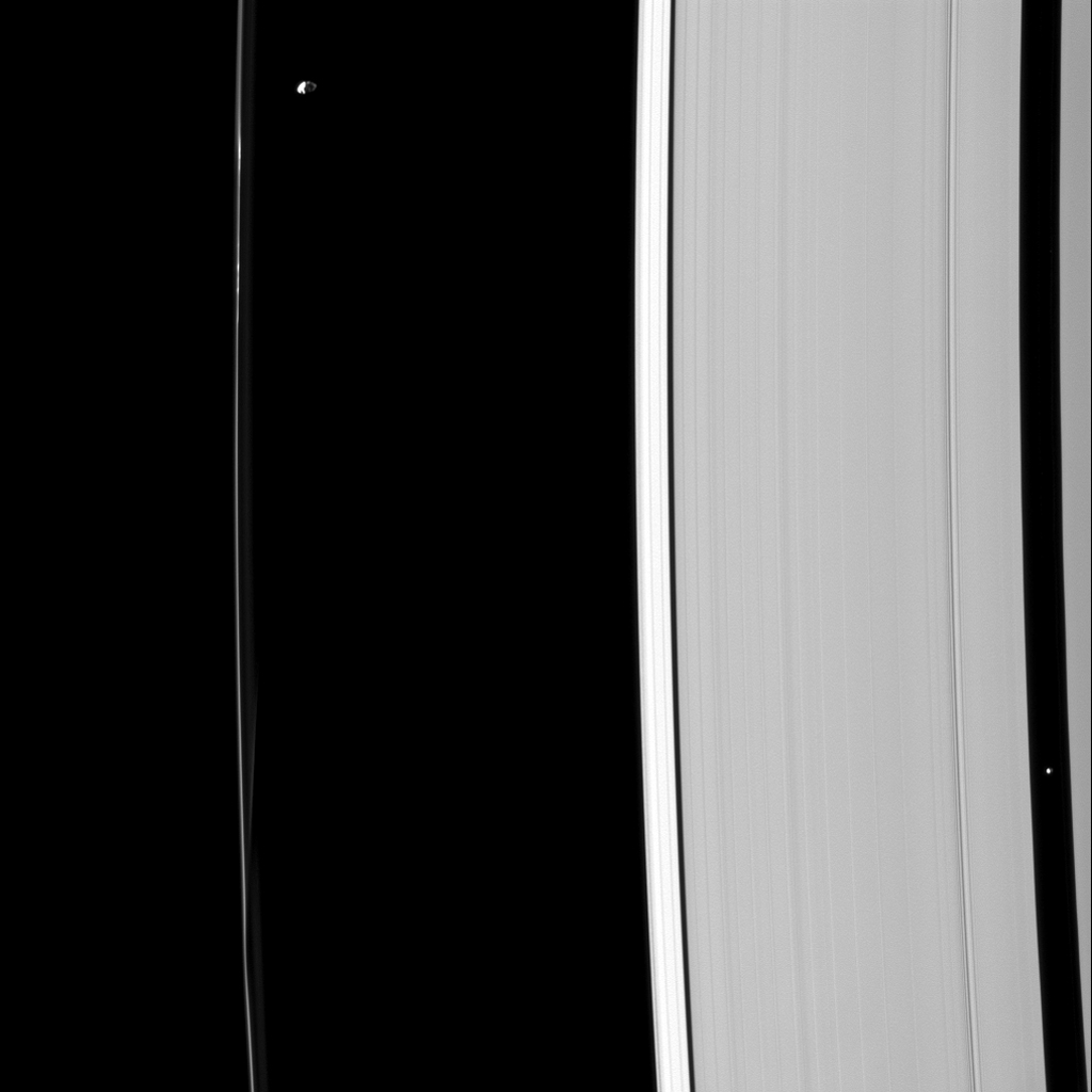 Although their gravitational effects on nearby ring material look quite different, Prometheus and Pan are both shepherd moons, holding back nearby ring edges in this image captured by NASA's Cassini spacecraft.