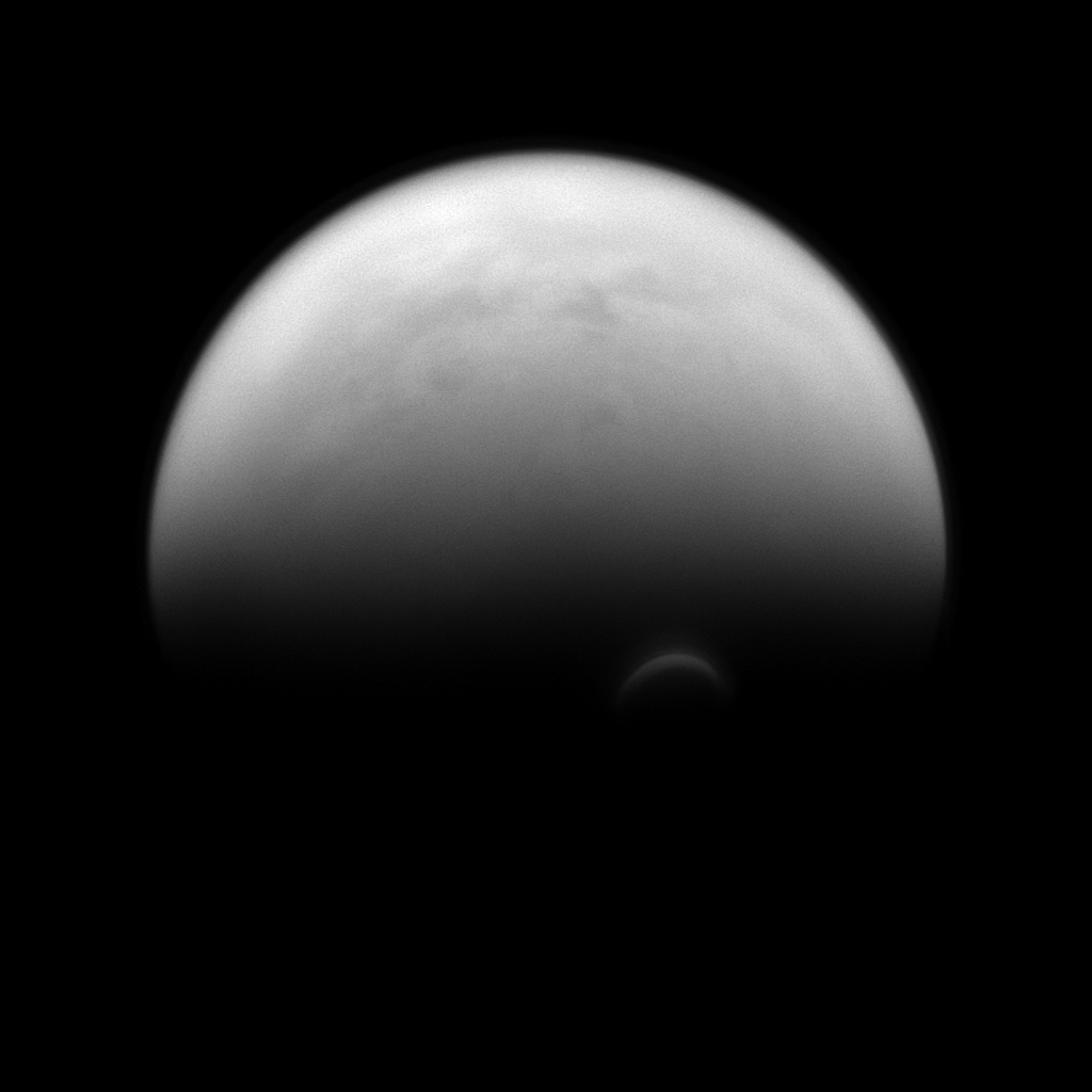 The sunlit edge of Titan's south polar vortex stands out distinctly against the darkness of the moon's unilluminated hazy atmosphere as seen by NASA's Cassini spacecraft.