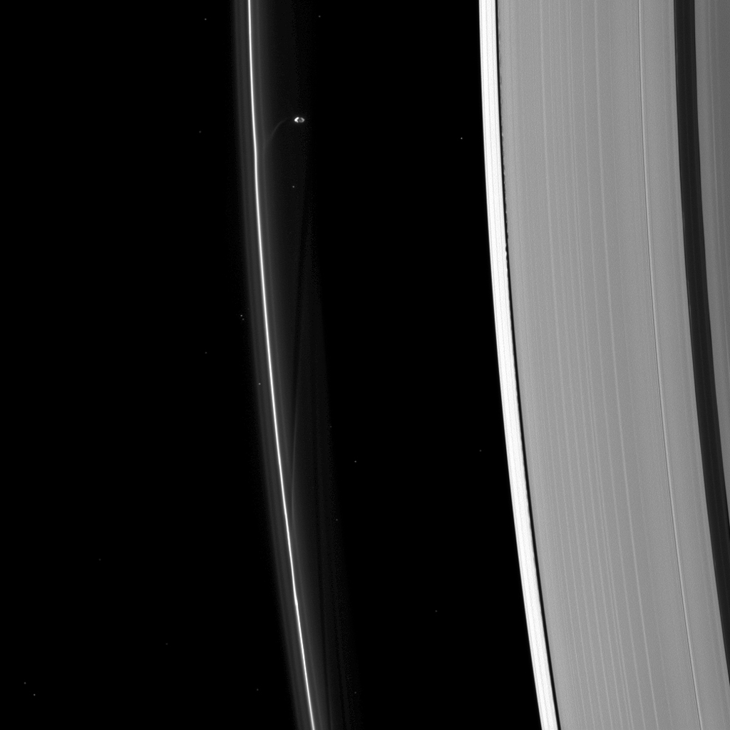 Prometheus, seen here by NASA's Cassini spacecraft, sculpting the F ring while Daphnis (too small to discern in this image) raises waves on the edges of the Encke gap.