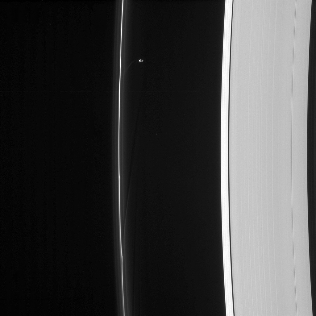 Saturn's moon Prometheus orbits near some of its handiwork in the F ring in this image from NASA's Cassini spacecraft. Prometheus and its partner Pandora gravitationally sculpt and maintain the narrow F ring.