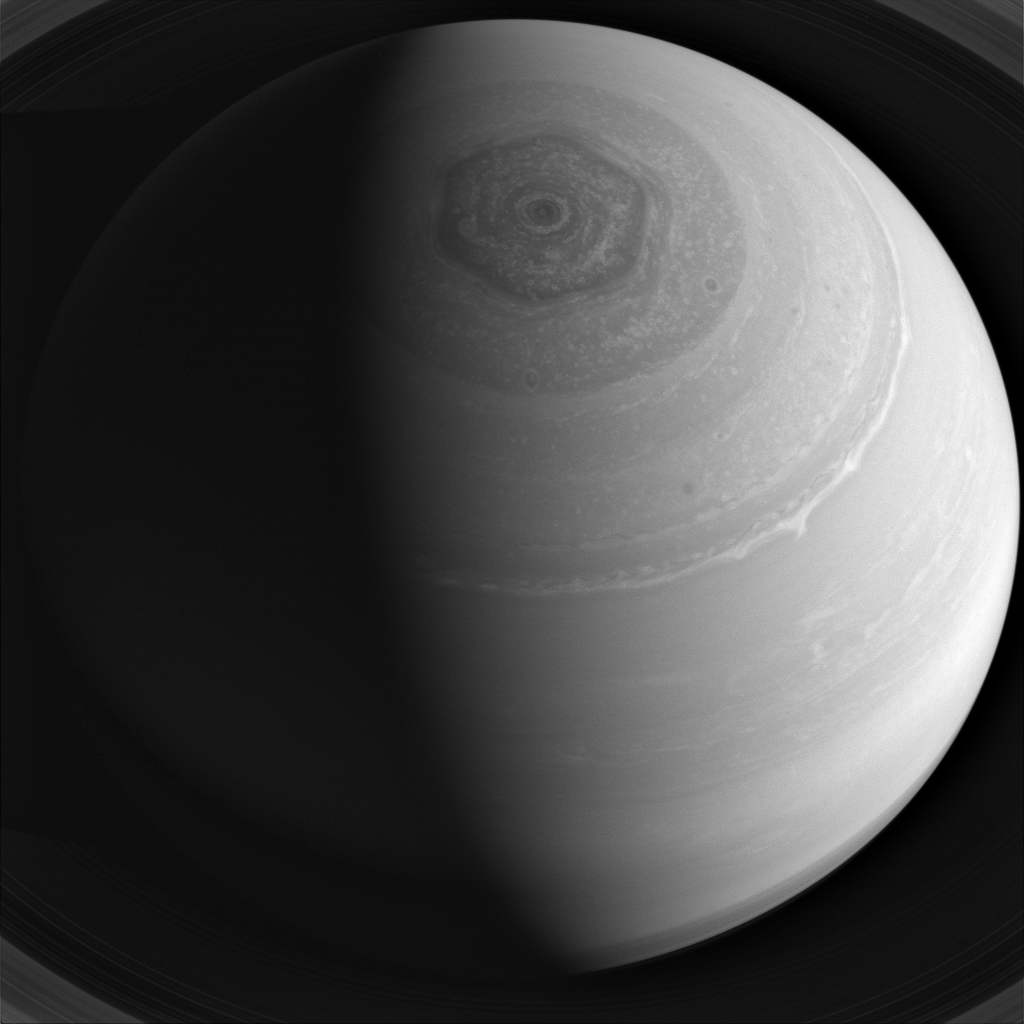 Saturn's winds race furiously around the planet, blowing at high speeds which form distinct belts and zones which encircle the planet's pole, as well as its famous hexagon as seen in this image from NASA's Cassini spacecraft.