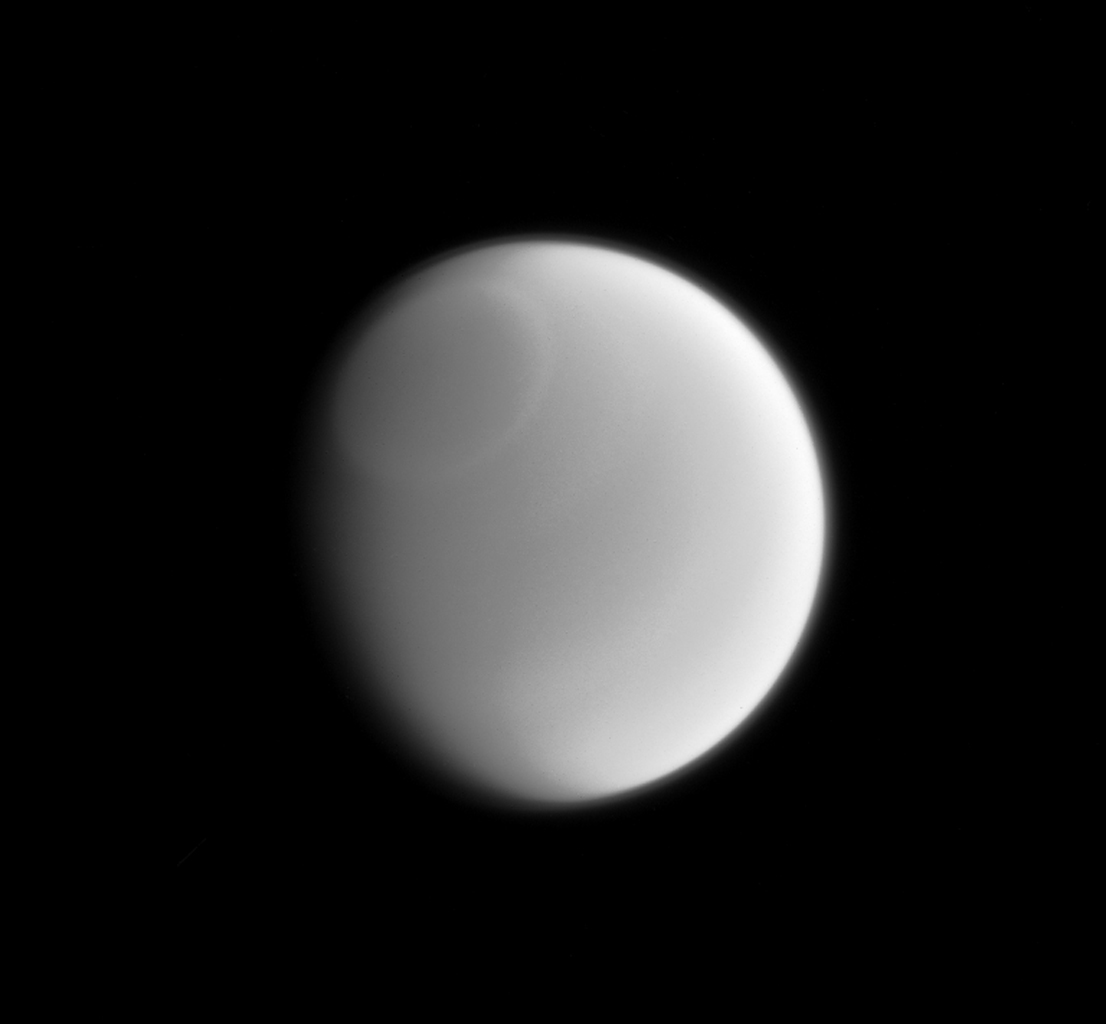 Only a sharp and careful eye can make out the subtle variations in Titan's clouds when viewed in visible light by NASA's Cassini spacecraft. This infrared image clearly reveals a band around the Titan's north pole.