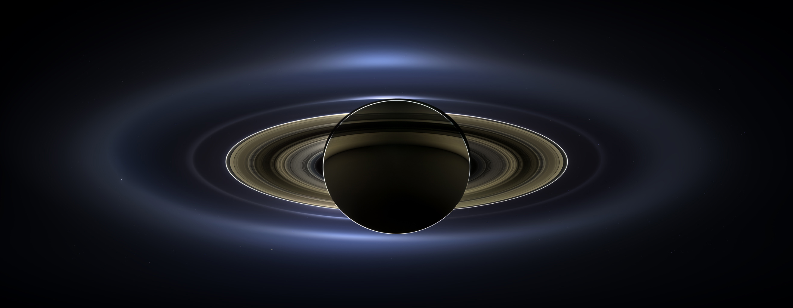 On July 19, 2013, Cassini slipped into Saturn's shadow and turned to image the planet, seven of its moons, its inner rings and Earth.