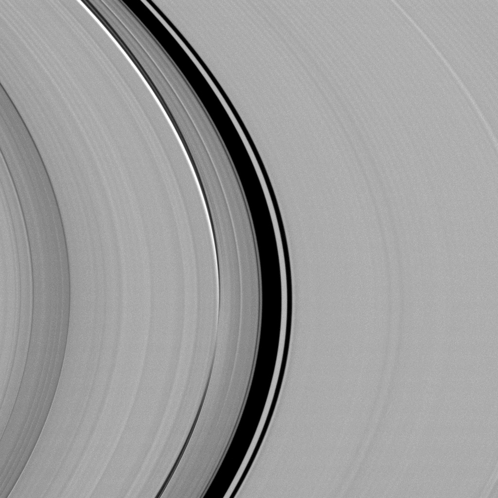 A dynamical interplay between Saturn's largest moon, Titan, and its rings is captured in this view from NASA's Cassini spacecraft.
