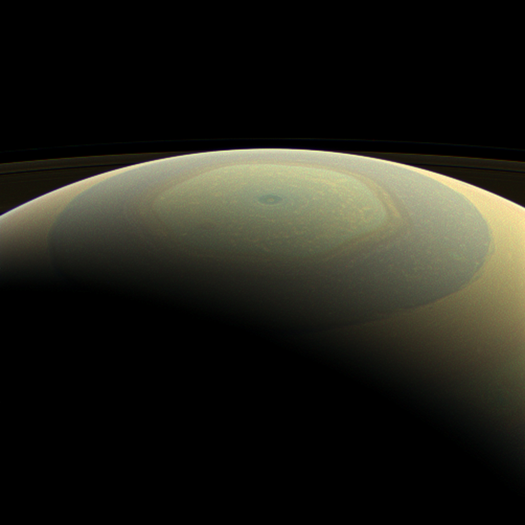 The globe of Saturn, seen here in natural color, is reminiscent of a holiday ornament in this wide-angle view from NASA's Cassini spacecraft.