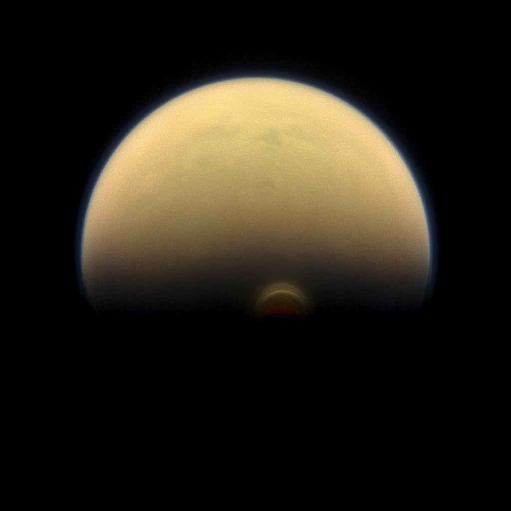 Slipping into shadow, the south polar vortex at Saturn's moon Titan still stands out against the orange and blue haze layers that are characteristic of Titan's atmosphere. Images like this, from NASA's Cassini spacecraft.
