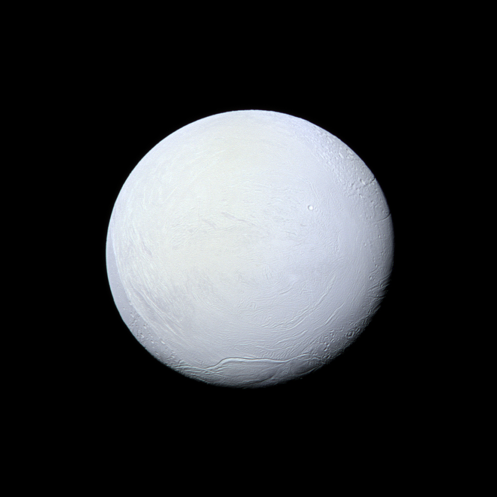 Saturn's moon Enceladus, covered in snow and ice, resembles a perfectly packed snowball in this image from NASA's Cassini spacecraft.