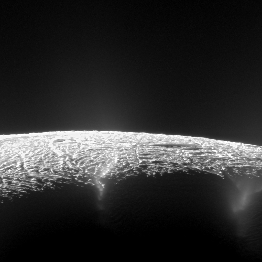 This dramatic view from NASA's Cassini spacecraft looks across the region of Enceladus' geyser basin and down on the ends of the Baghdad and Damascus fractures that face Saturn.