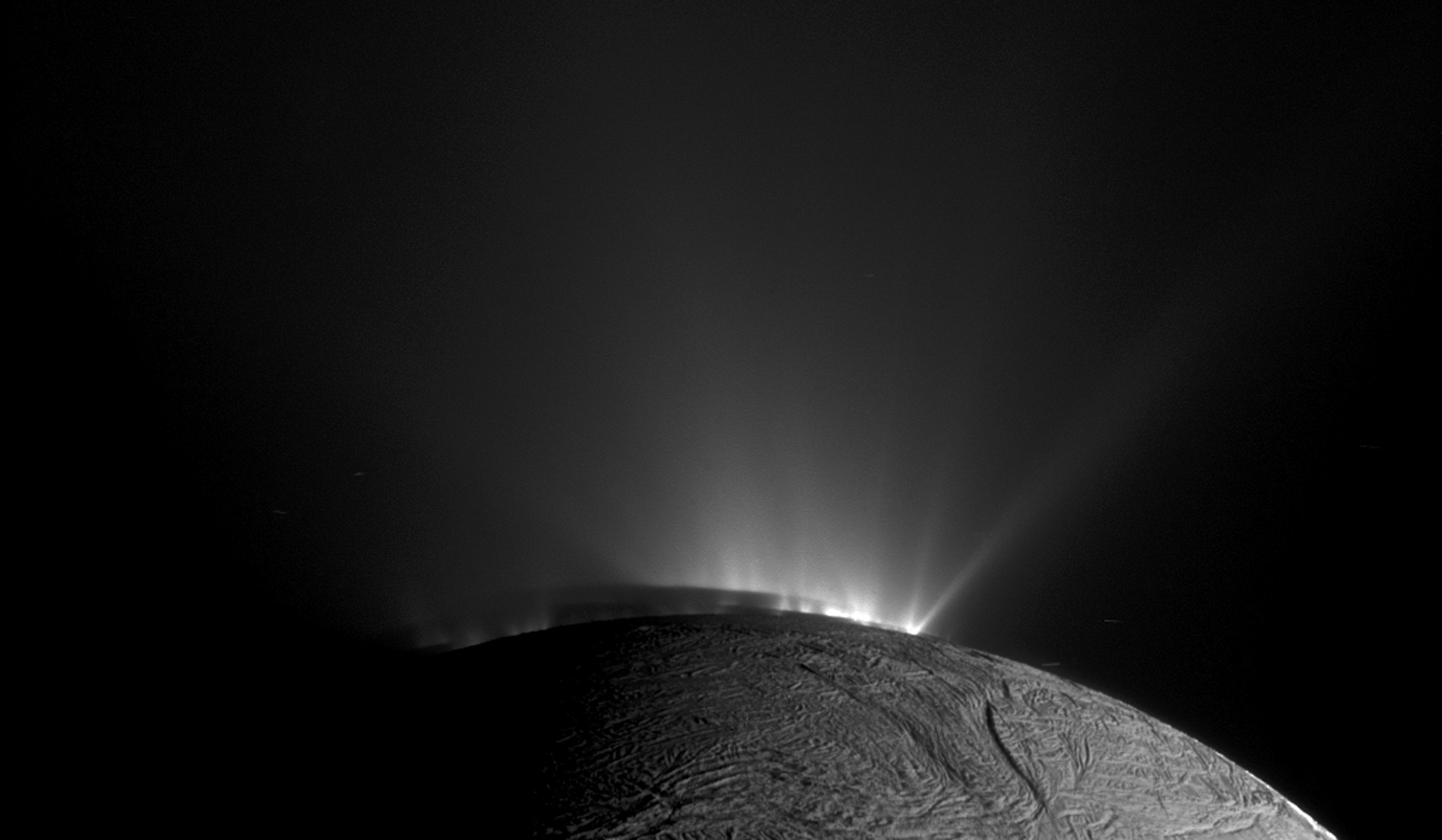 This image from NASA's Cassini spacecraft, one of those acquired in the survey conducted by the Cassini imaging science team of the geyser basin at the south pole of Enceladus, was taken as Cassini was looking across the moon's south pole.